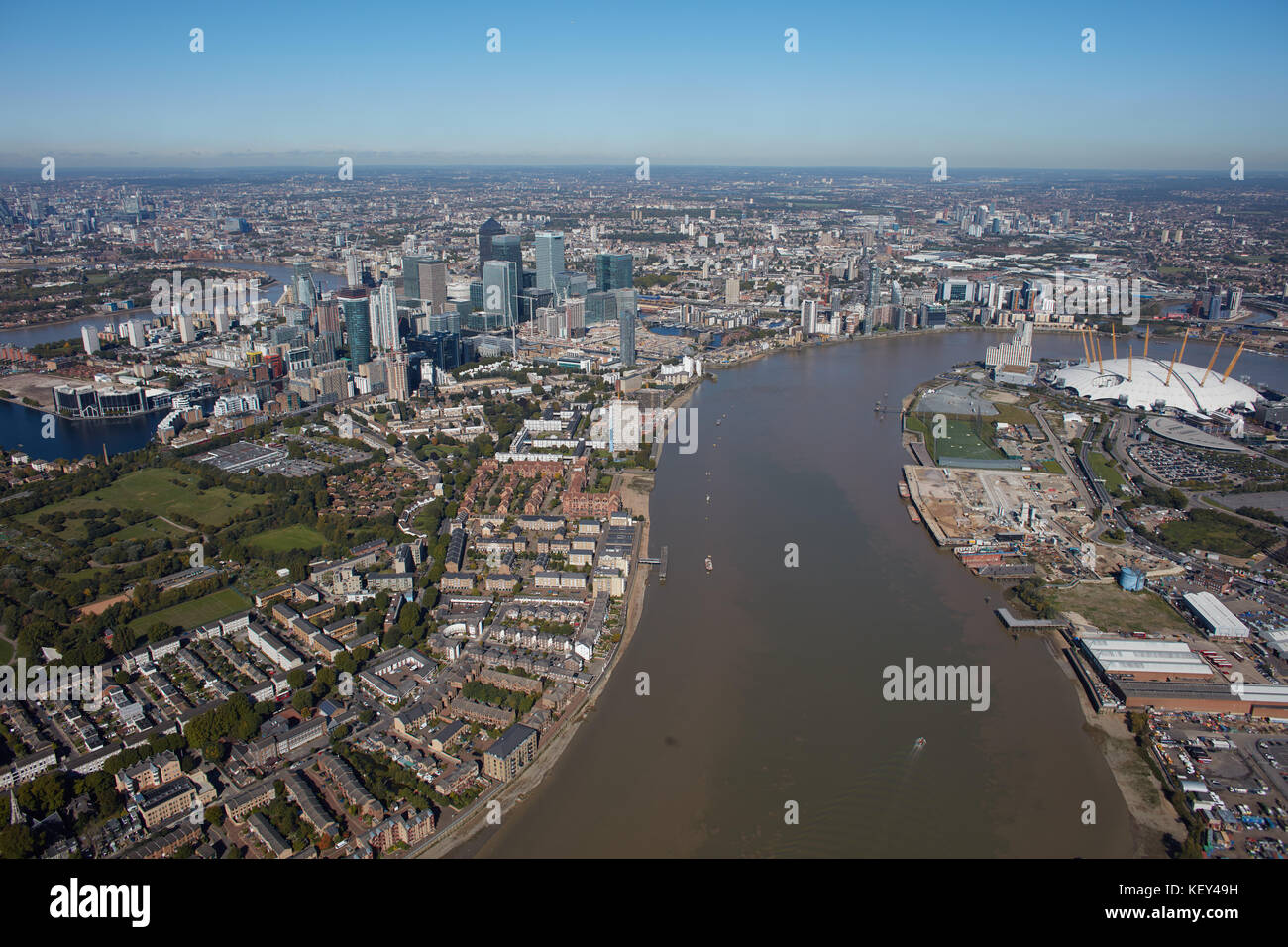 An aerial view from the River Thames showing the Isle of Dogs and the O2 Arena - Stock Image