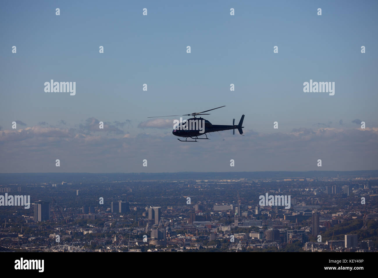 An air to air view of an AS355 Twin Squirrel being used for aerial photography over Central London - Stock Image