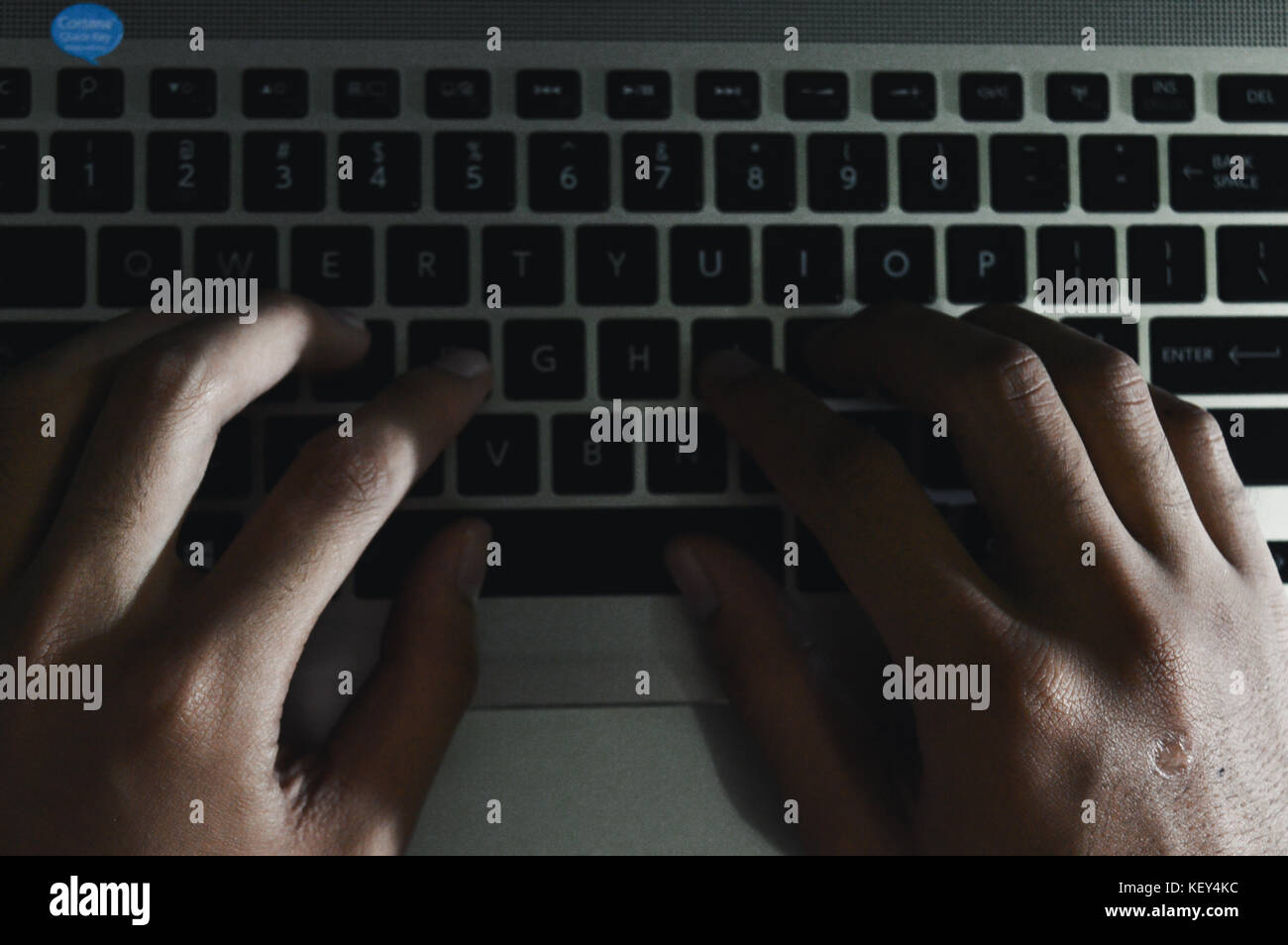 human finger is typing on a keyboard - Stock Image
