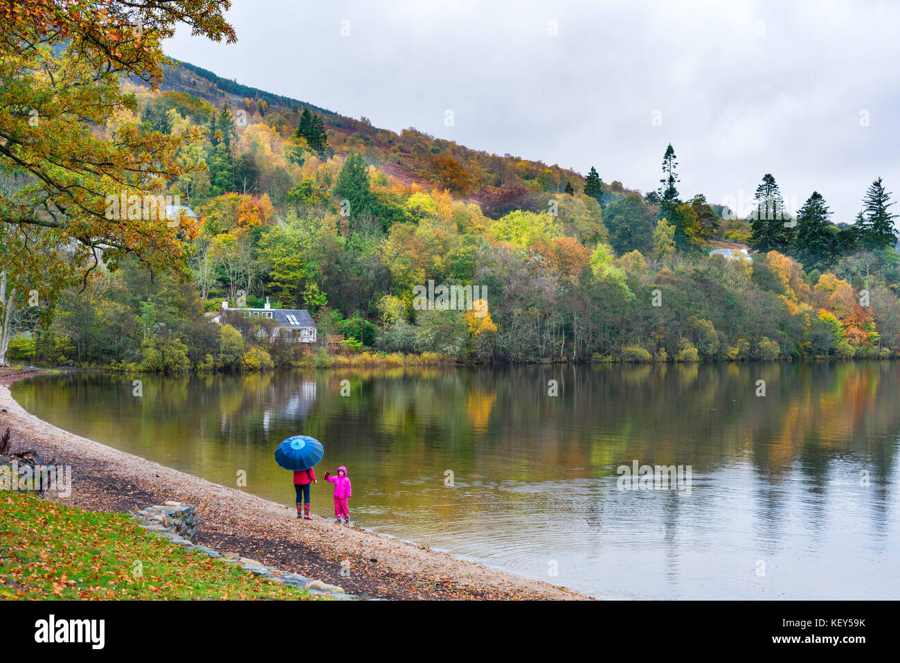 View of waterfront at village of Kenmore during autumn on Loch Tay in Perthshire , Scotland, United Kingdom. - Stock Image