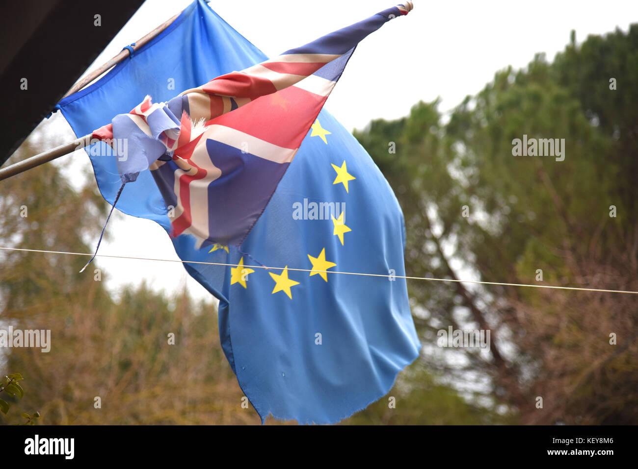 union jack and EU European flags tangled up - Stock Image