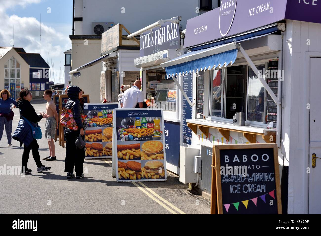 Fish and chips and ice cream being sold on Lyme Regis sea front Dorset England UK - Stock Image