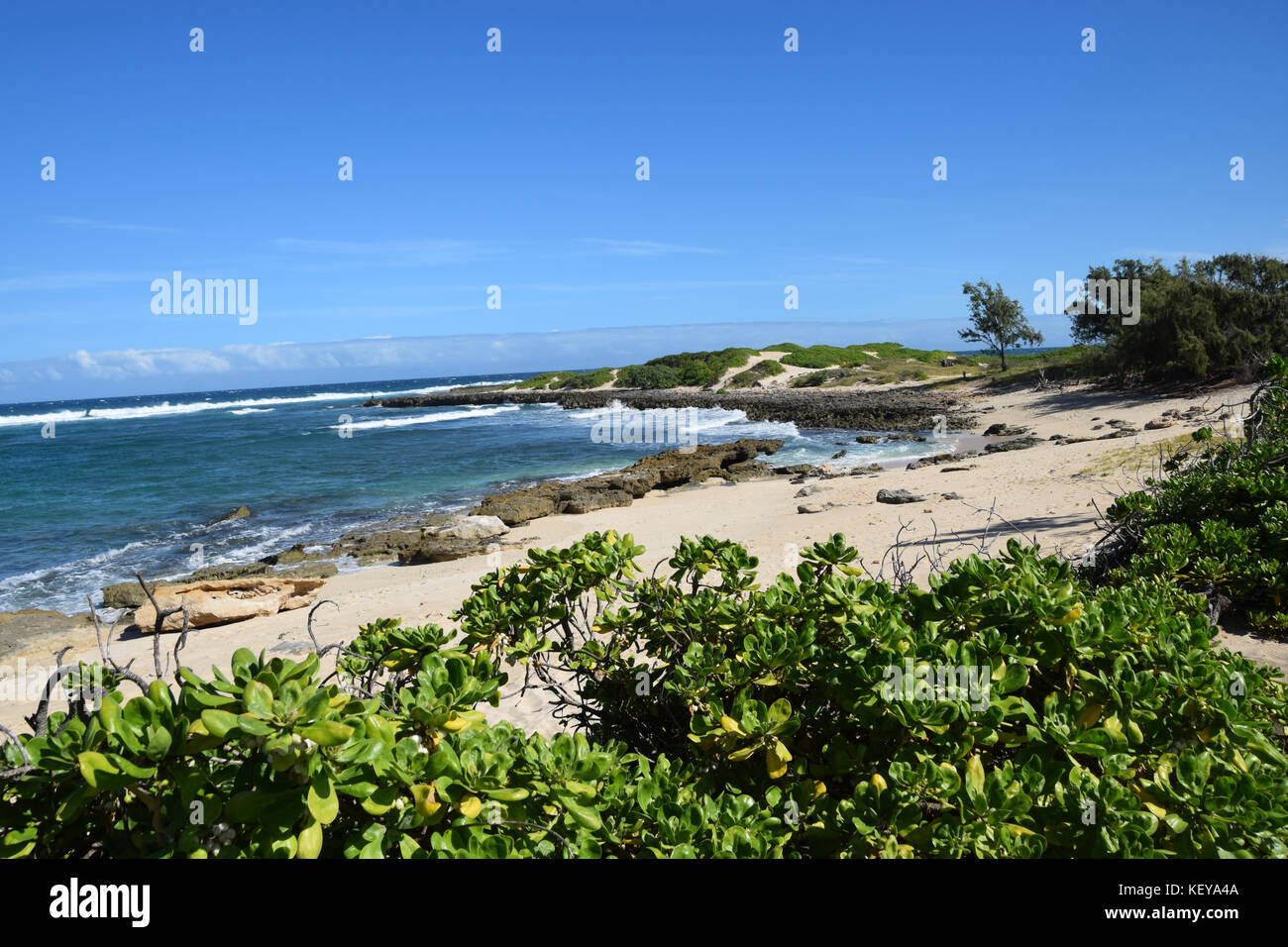 Hiking the Kahuku shoreline on the Oahu's North Shore is a beautiful way to discover Hawaii Stock Photo
