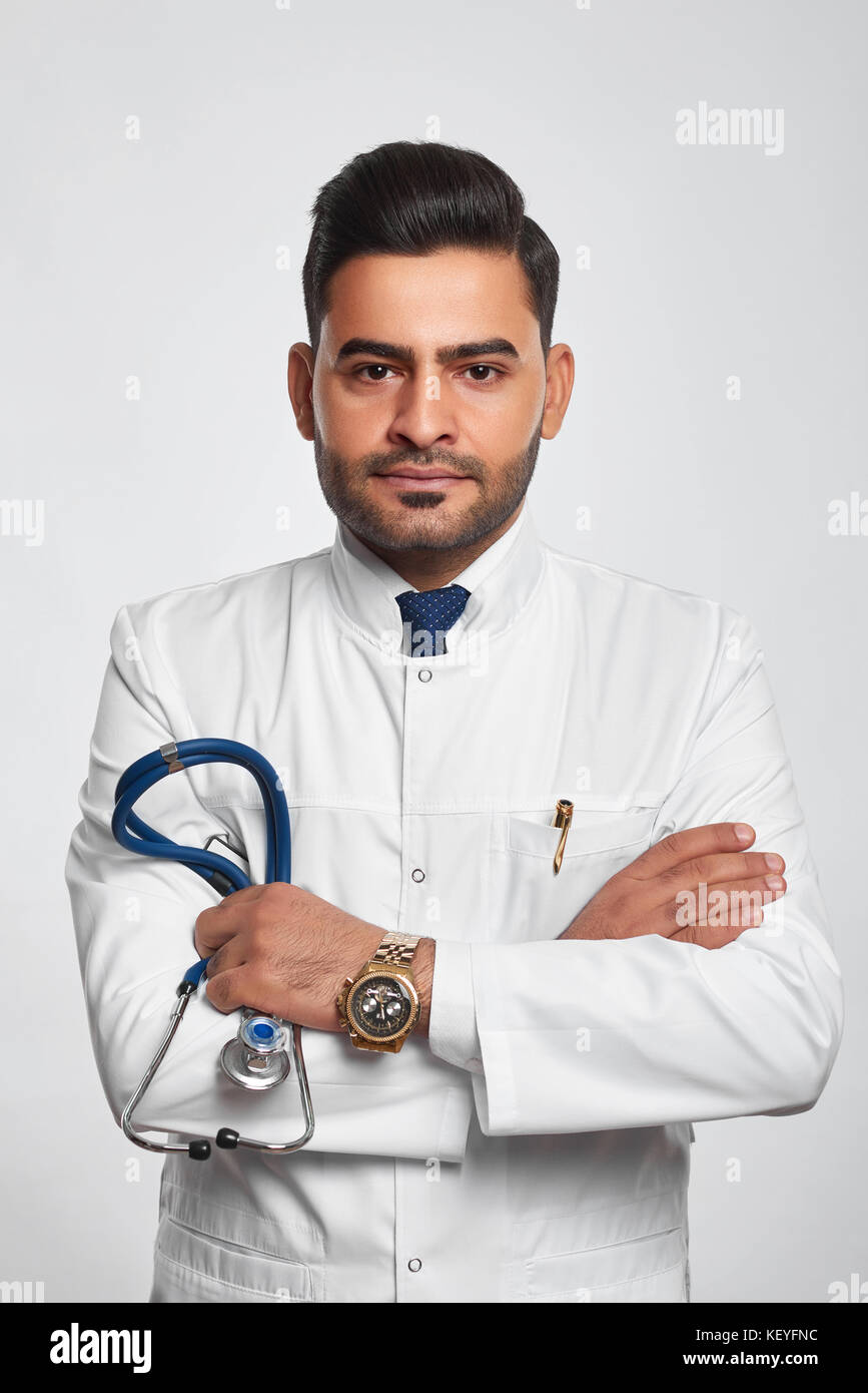 Male doctor posing at studio - Stock Image