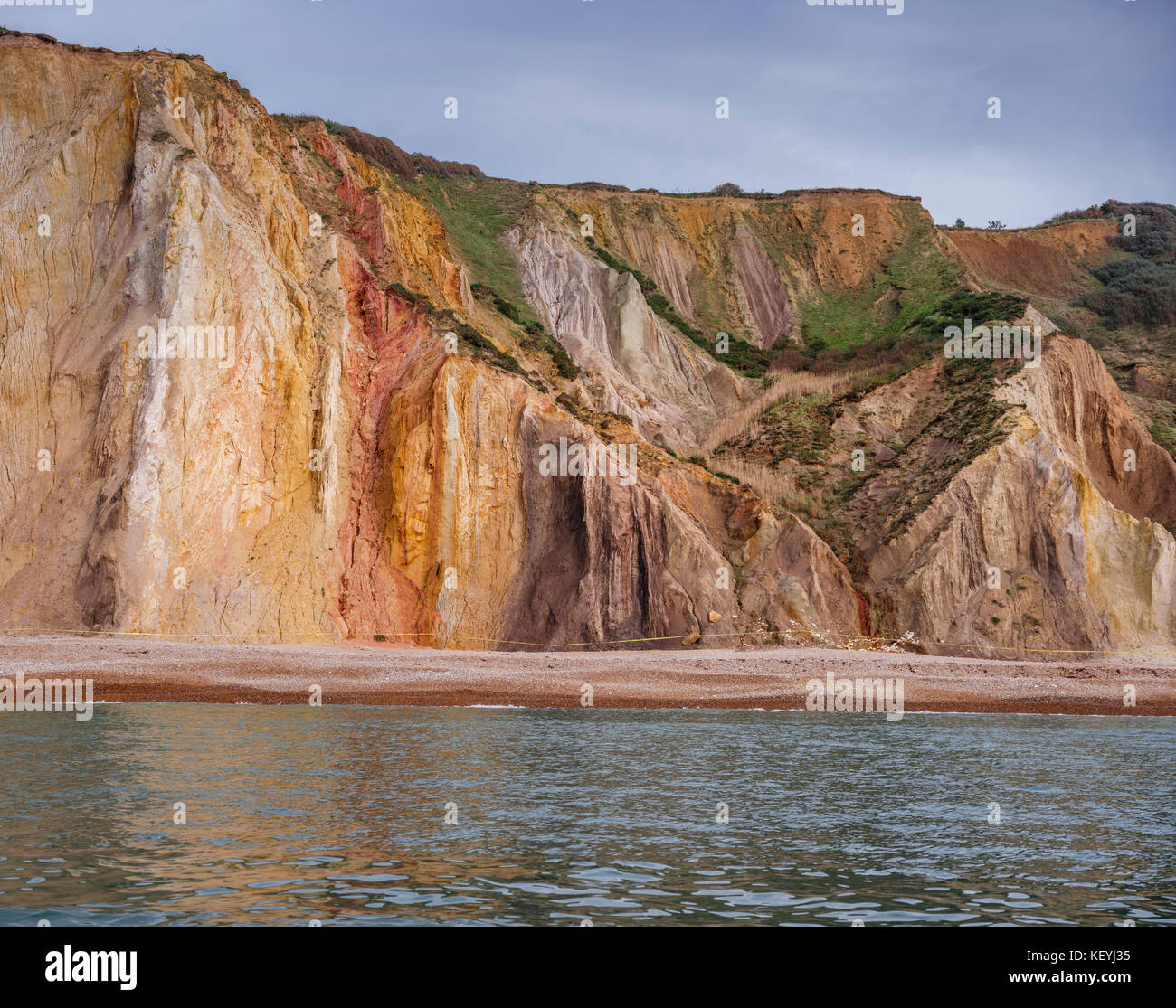 The mult-coloured sands of Alum Bay on the Isle of Wight. - Stock Image