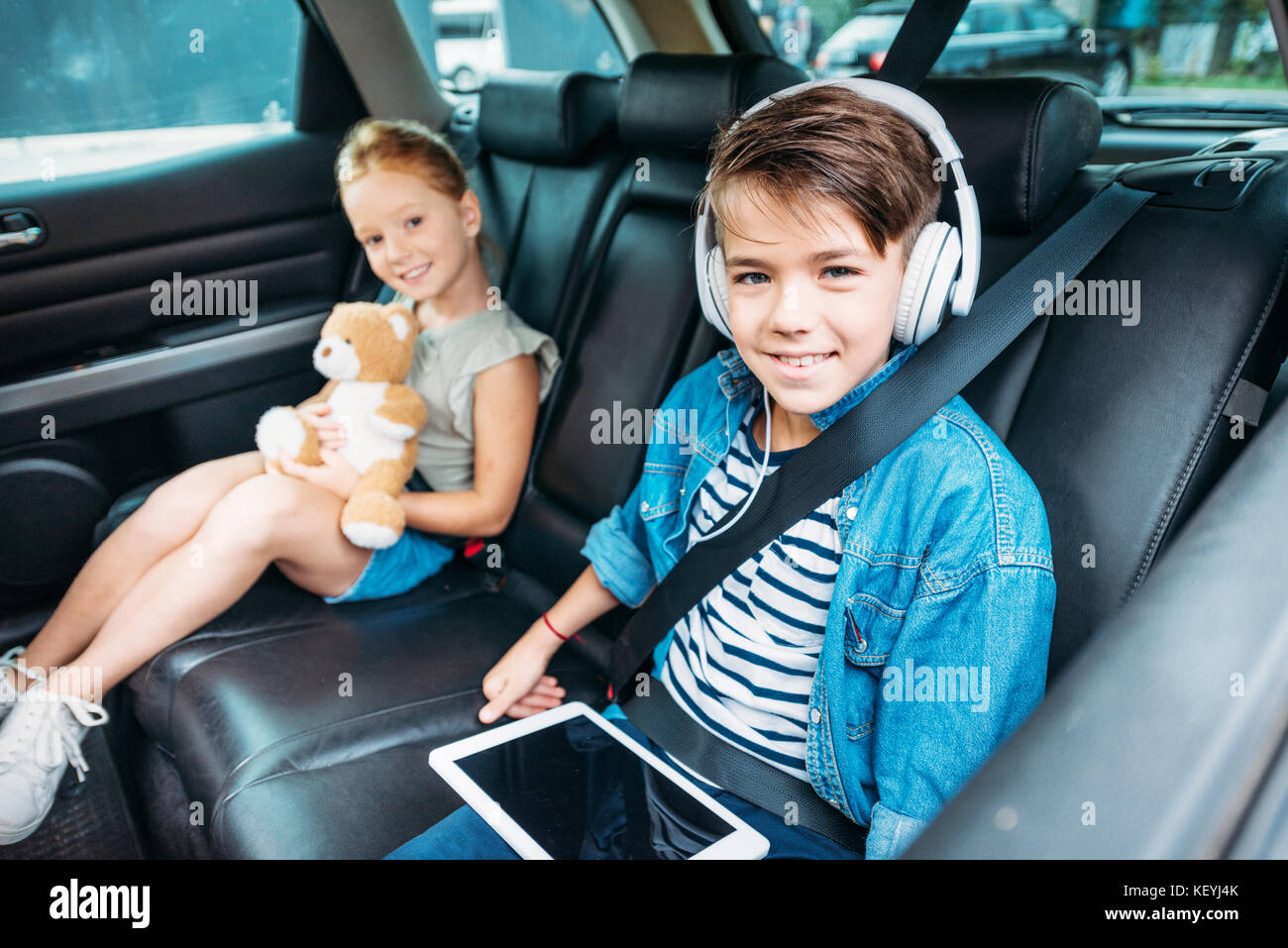 brother and sister ready for car trip - Stock Image