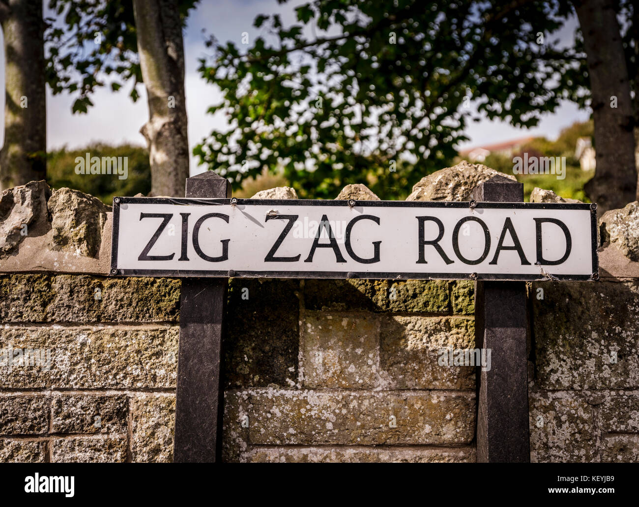 A road sign for Zig Zag Road in Ventnor on the Isle of Wight. - Stock Image