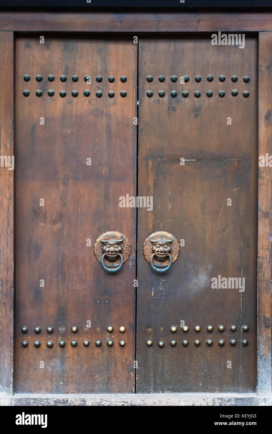 Old brown chinese traditional wooden gate with lion door knocker & Old brown chinese traditional wooden gate with lion door knocker ...