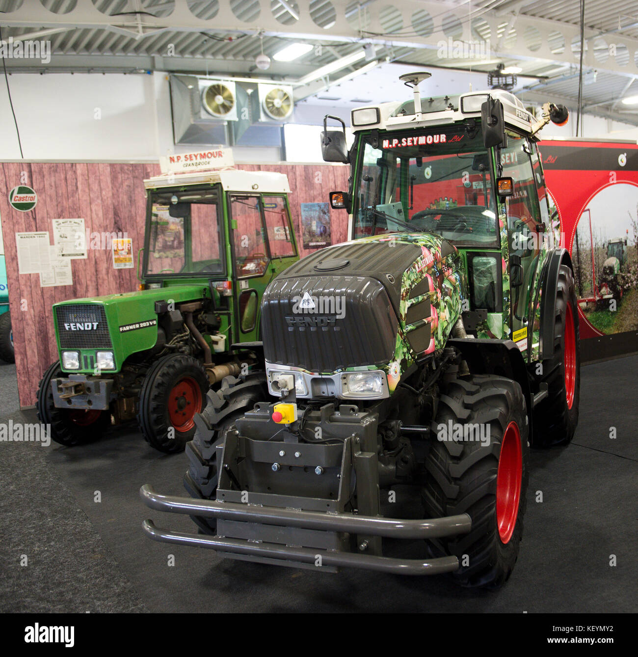 National Fruit Show, Detling, 24th October 2017. Old and new technology. An old fruit farm specific tractor with - Stock Image
