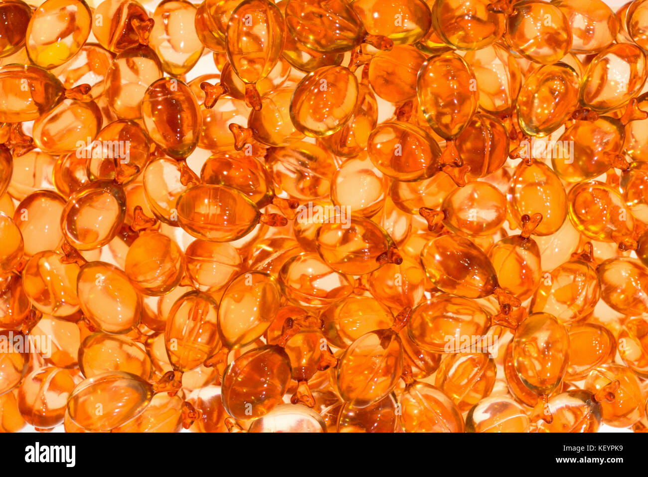 hair and skin vitamin serum in orange soft capsules, background and texture Stock Photo
