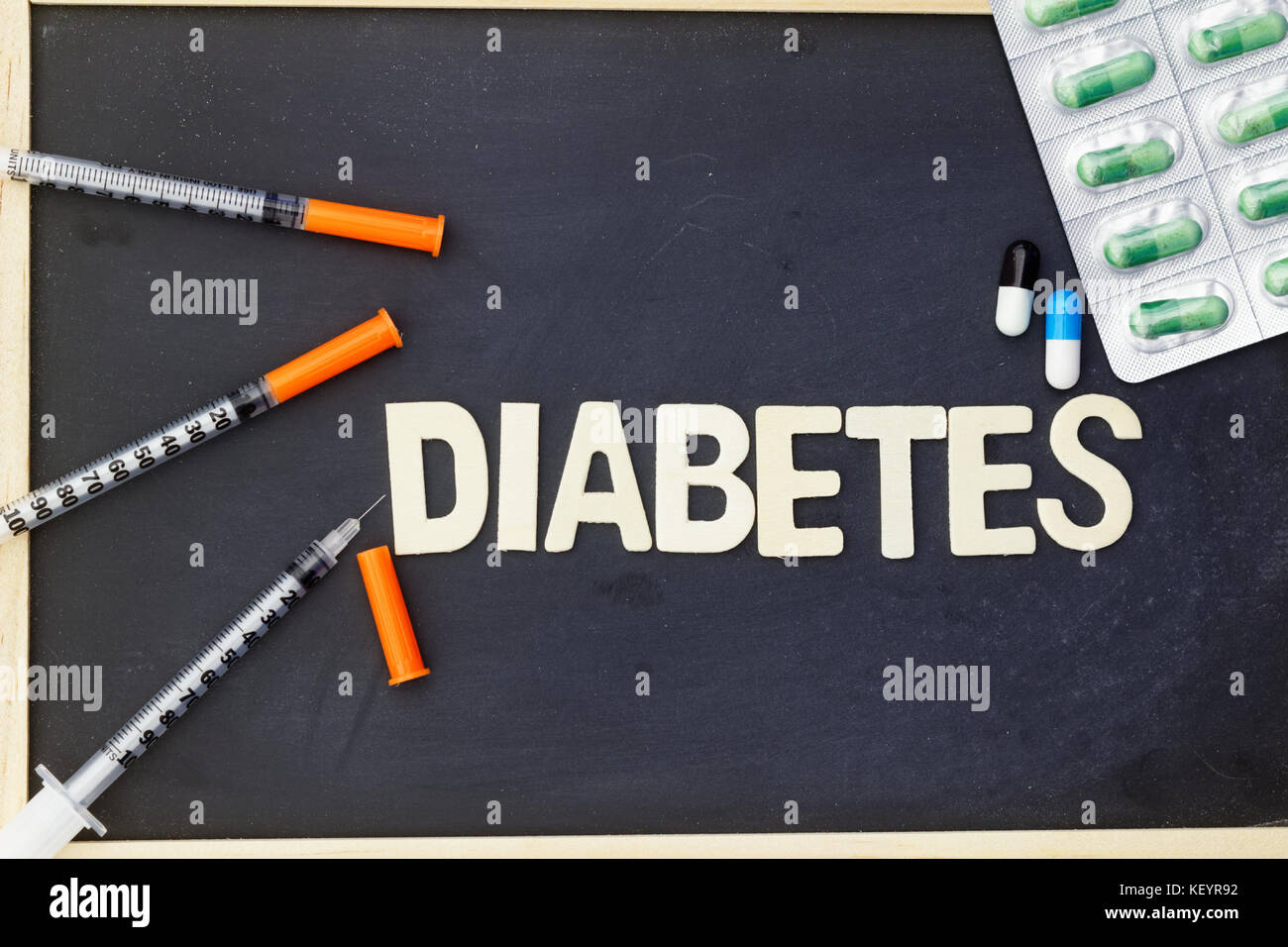 Word DIABETES with insulin syringe and medication - Stock Image