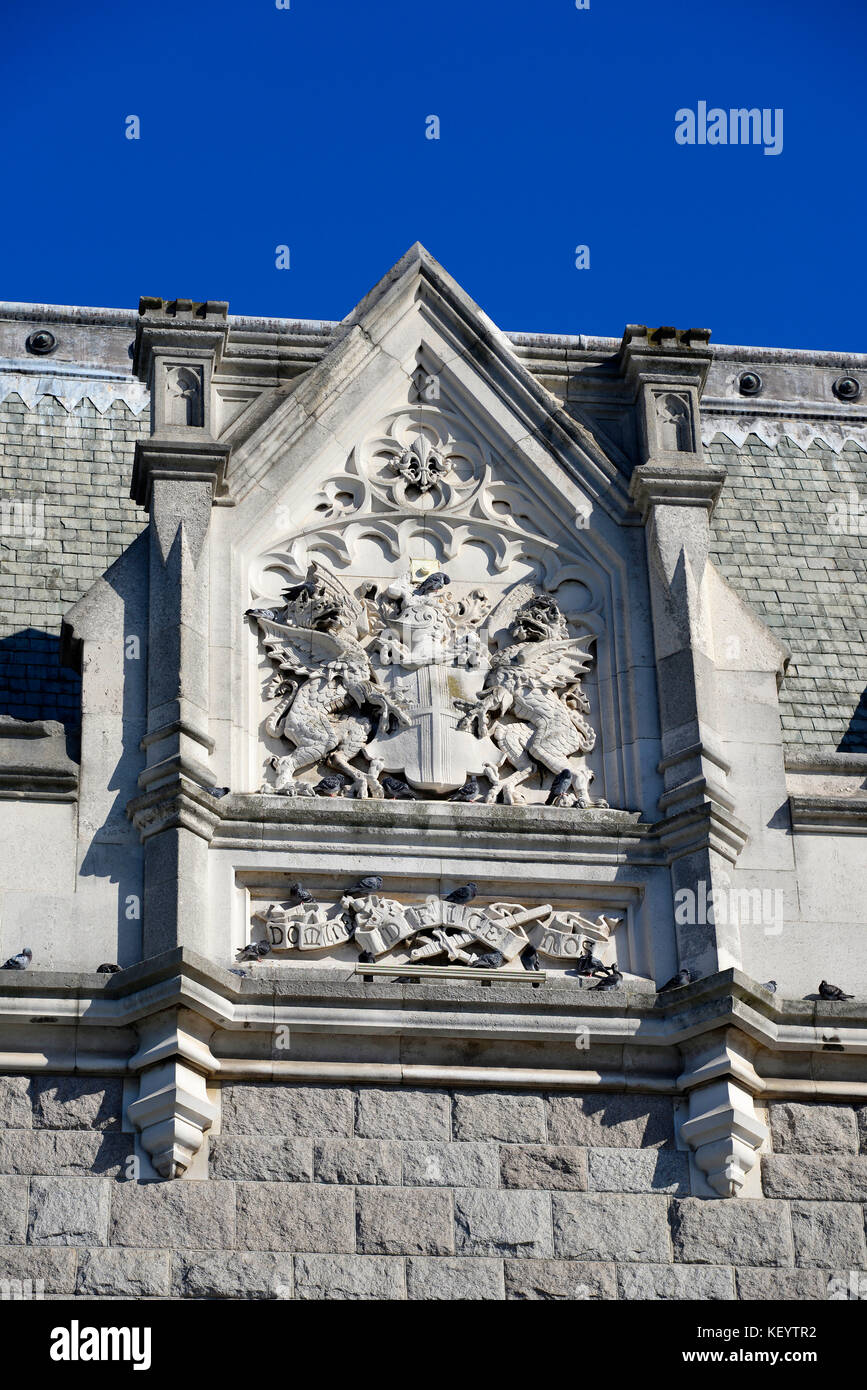 Coat of arms of the City of London on Tower Bridge, London. Carved in stone. Space for copy - Stock Image