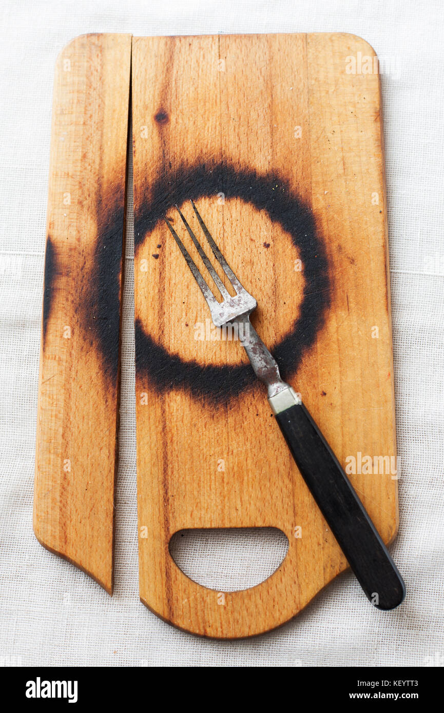 burnt chopping board - Stock Image