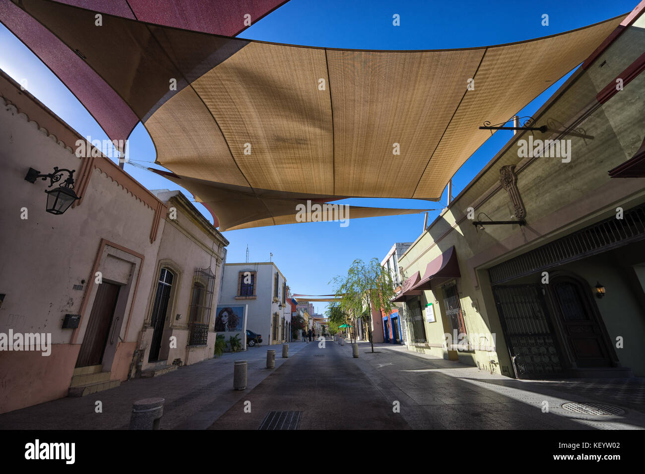 """January 16, 2016 Monterrey, Mexico: shade over the street in the historic old town called 'Barrio Antiguo"""" Stock Photo"""