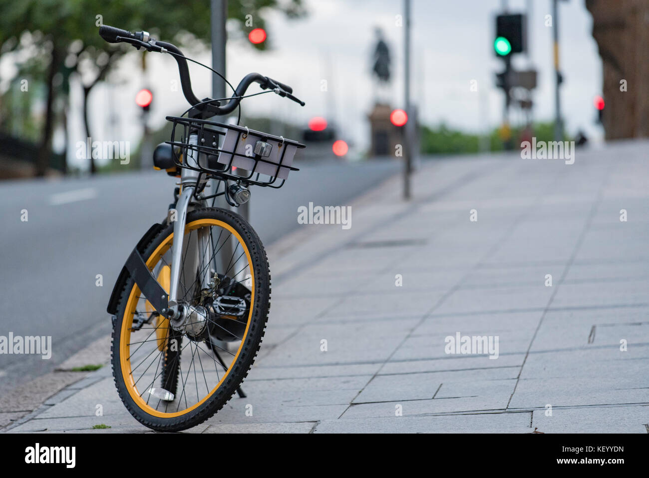 One of the many new hire bikes available in Sydney stands waiting to be rented - Stock Image