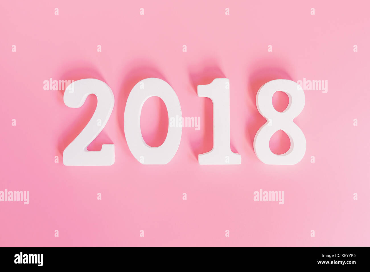 ada6e3ff59938 top view number of 2018 for new year on pink pastel color. - Stock Image