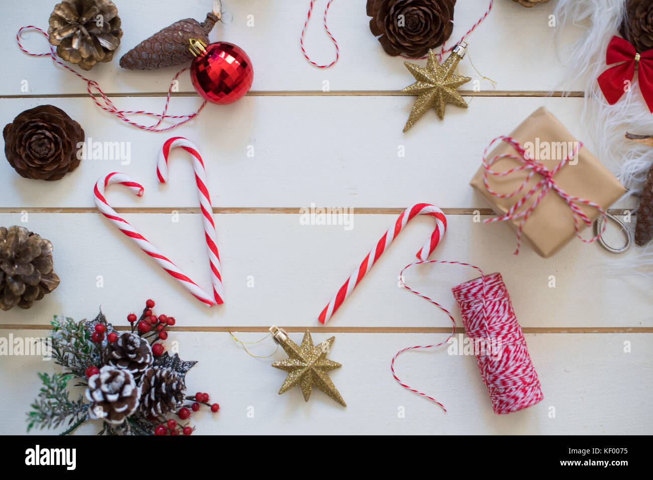 Christmas present with red ribbon on white wooden background in vintage style Stock Photo