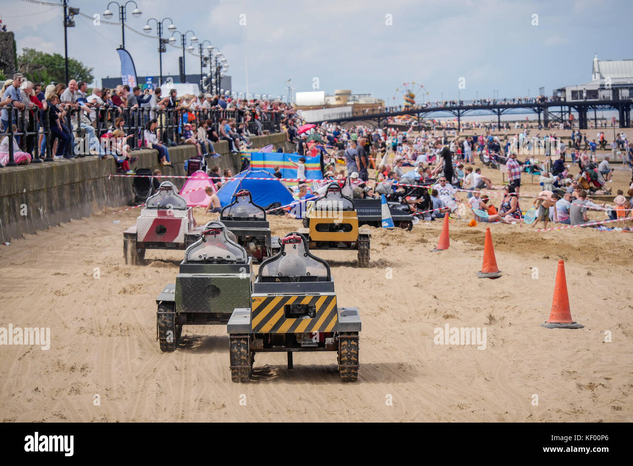 Children play in miniature model tanks on the beach at The National Armed Forces Day, Cleethorpes 2016 - Stock Image