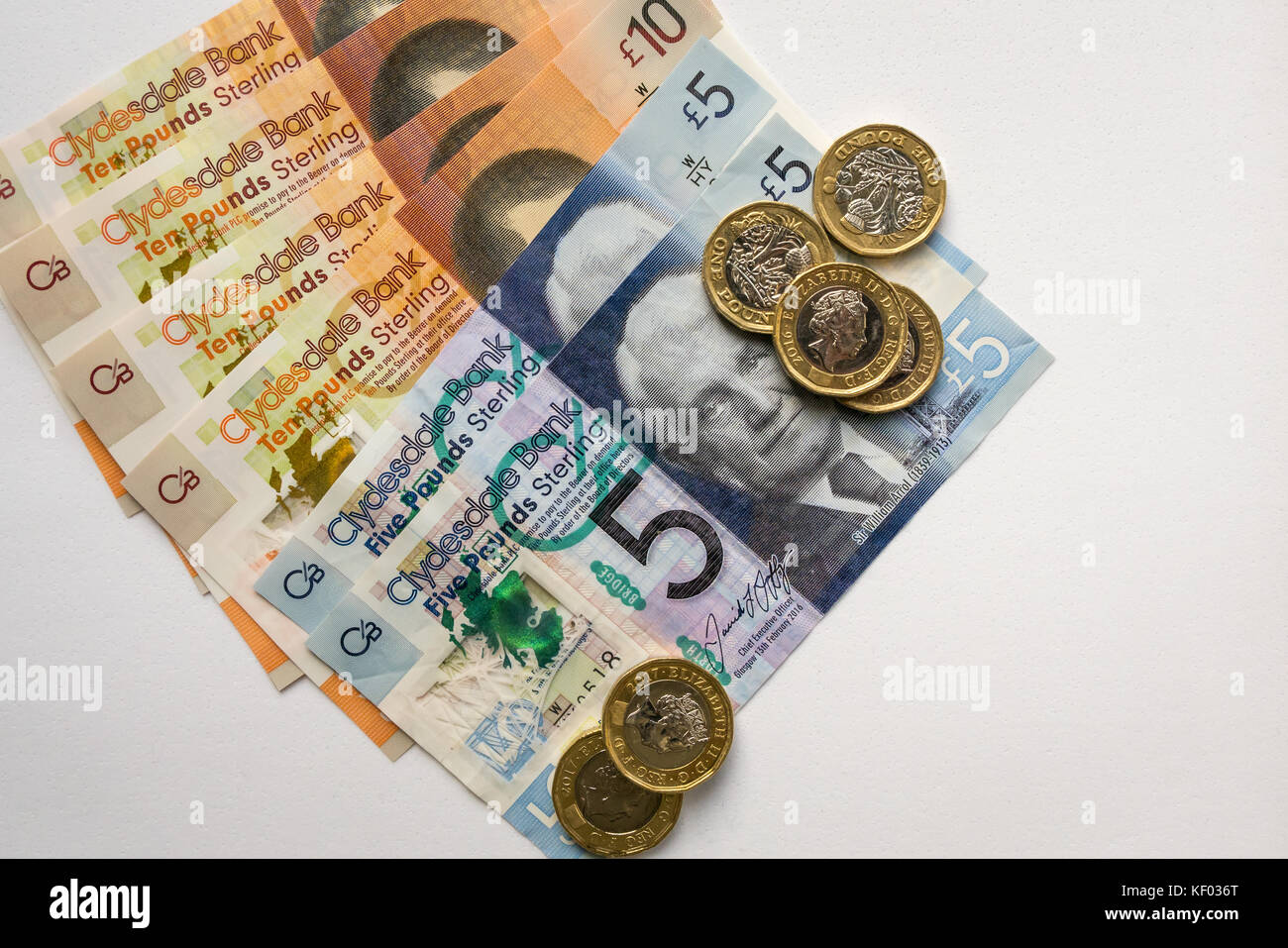 New plastic polymer Clydesdale Bank Scottish ten £10, five pounds £5 banknotes and new hexagonal one pound - Stock Image