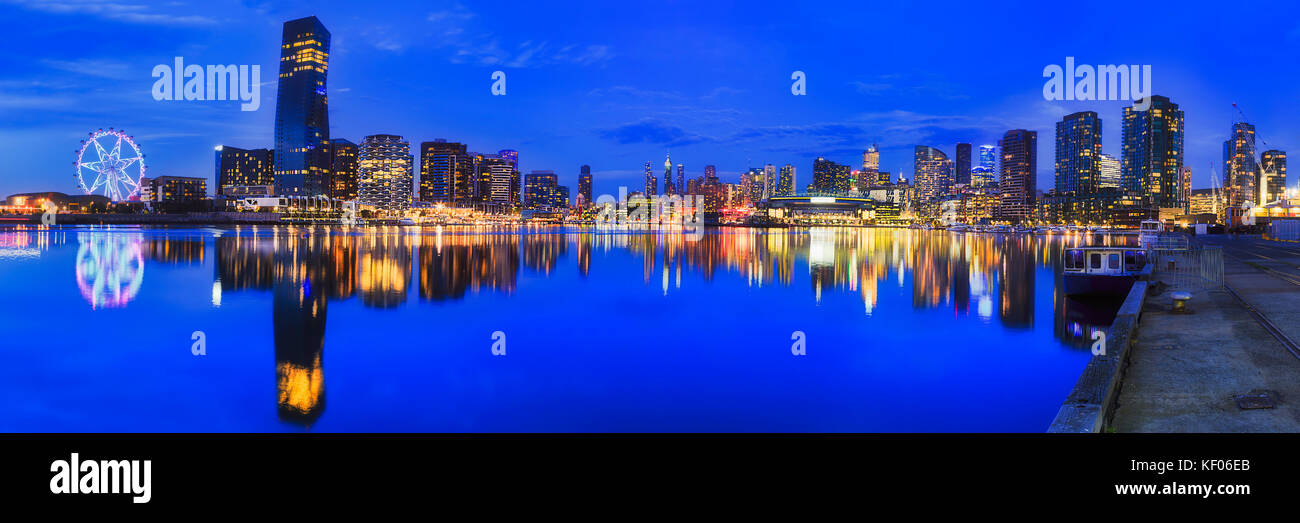 Melbourne docklands suburb with modern high-rise towers at sunset relecting in Yarra river. - Stock Image