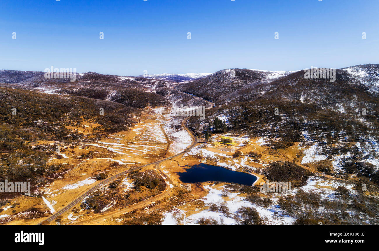 Elevated view over Diggers Creek and Sponars chalet on Kosciuszko road of Perisher valley in the middle of Australian - Stock Image
