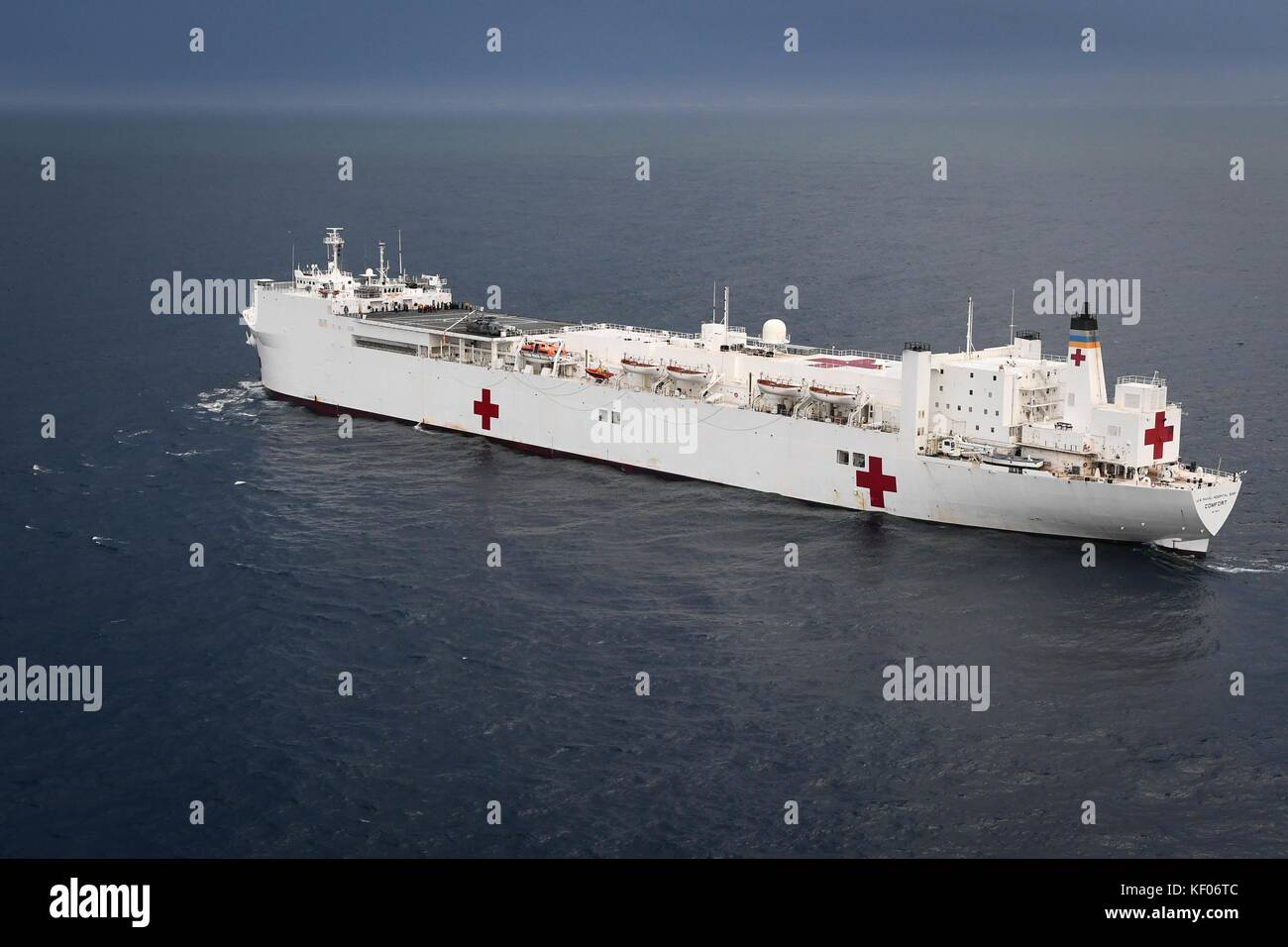 The U.S. Navy Mercy-class hospital ship USNS Comfort steams underway on the way to provide disaster relief support - Stock Image