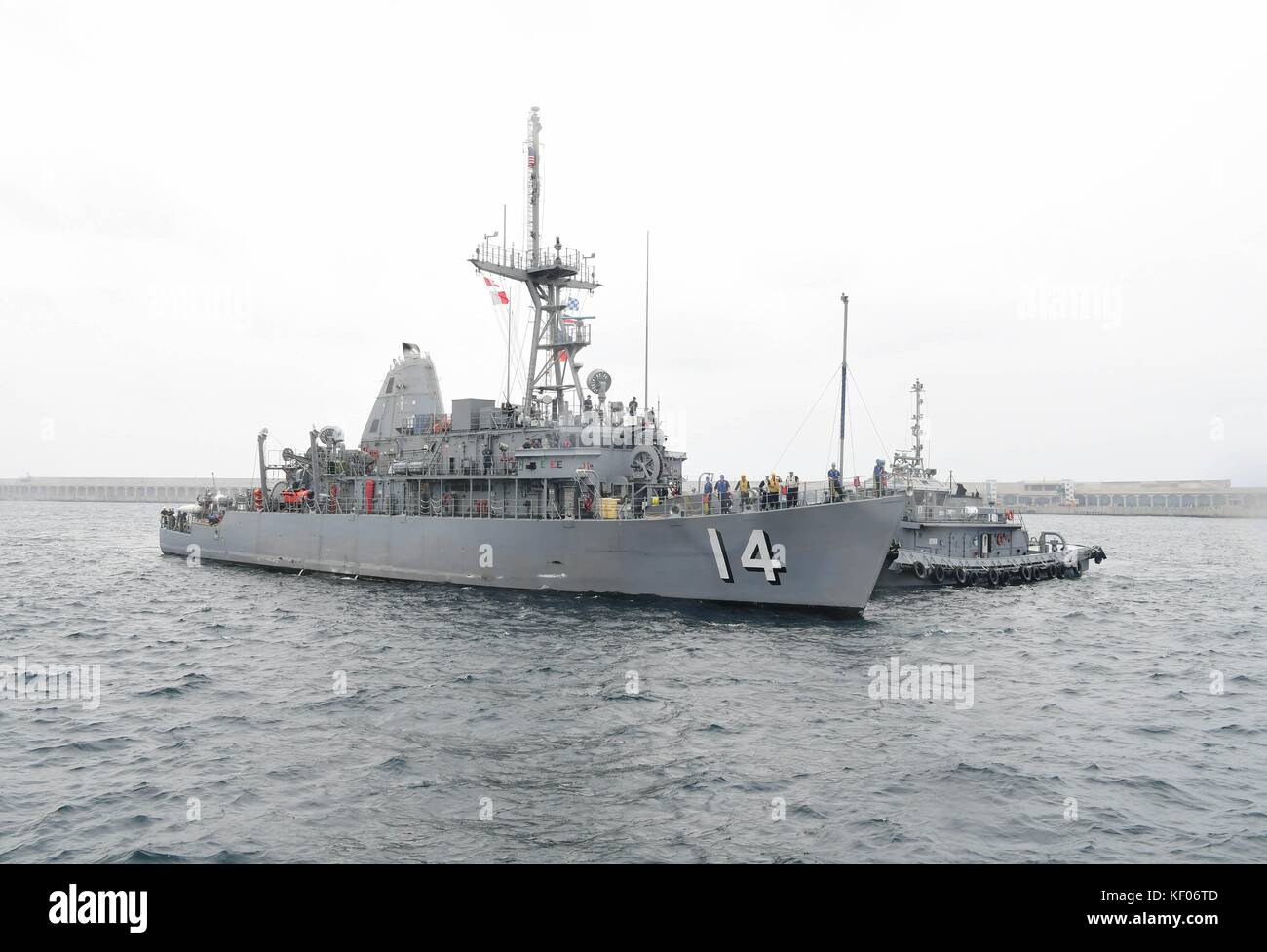The U.S. Navy Avenger-class mine countermeasures ship USS Chief arrives at Jeju Island for a port visit September Stock Photo