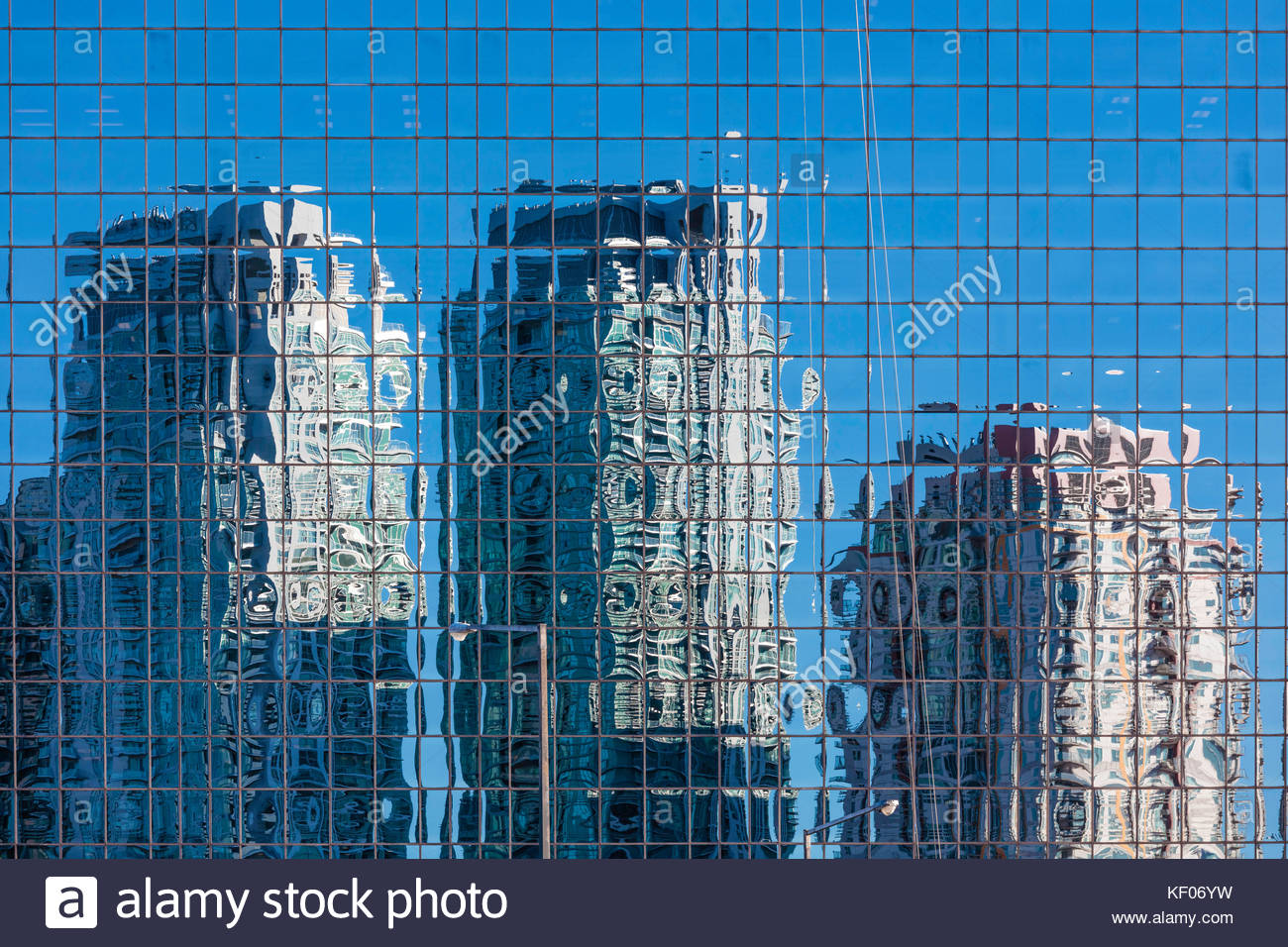 Condo buildings reflected in office building glass curtain wall in Scarborough area of Toronto Ontario Canada - Stock Image