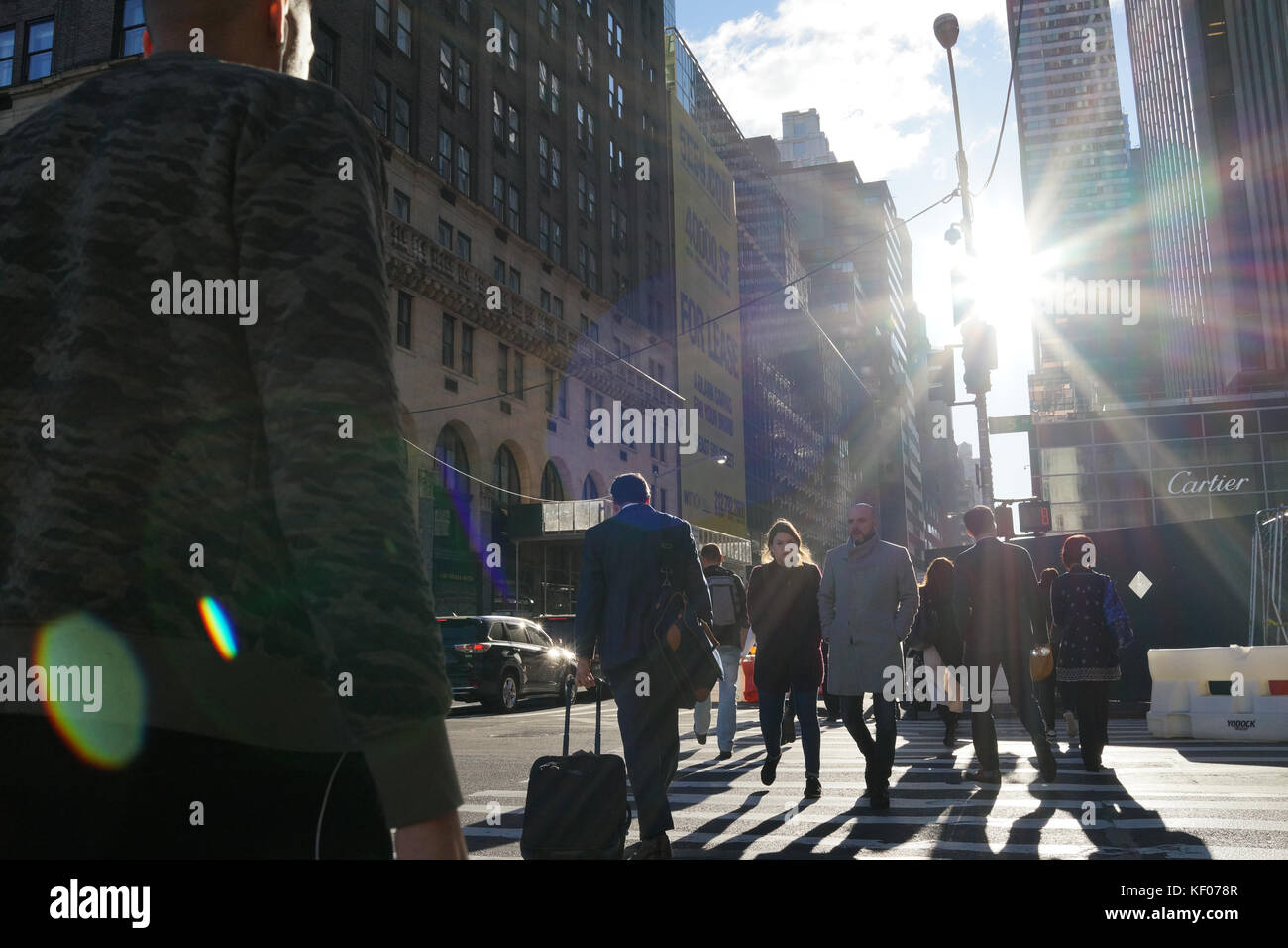 Smart pedestrians at rush hour, New York City - Stock Image