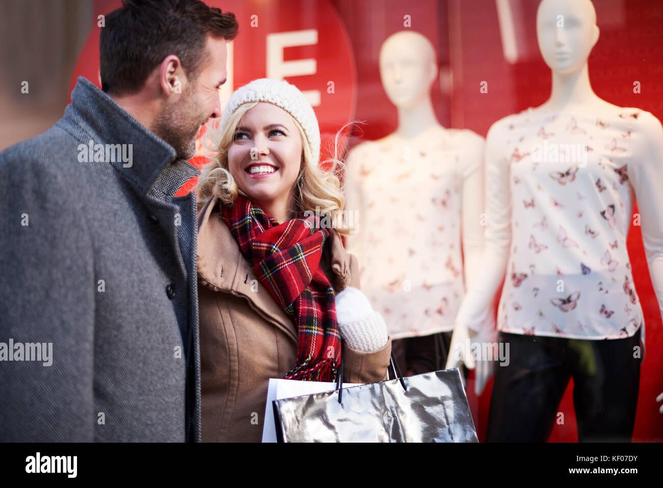 Couple spending money on new seasonal clothes - Stock Image