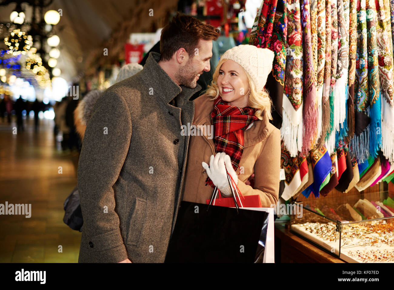 COuple shopping in the market square - Stock Image