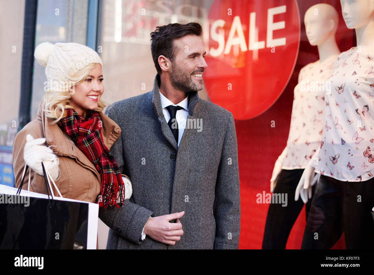 Lovely couple doing the shopping in the city Stock Photo
