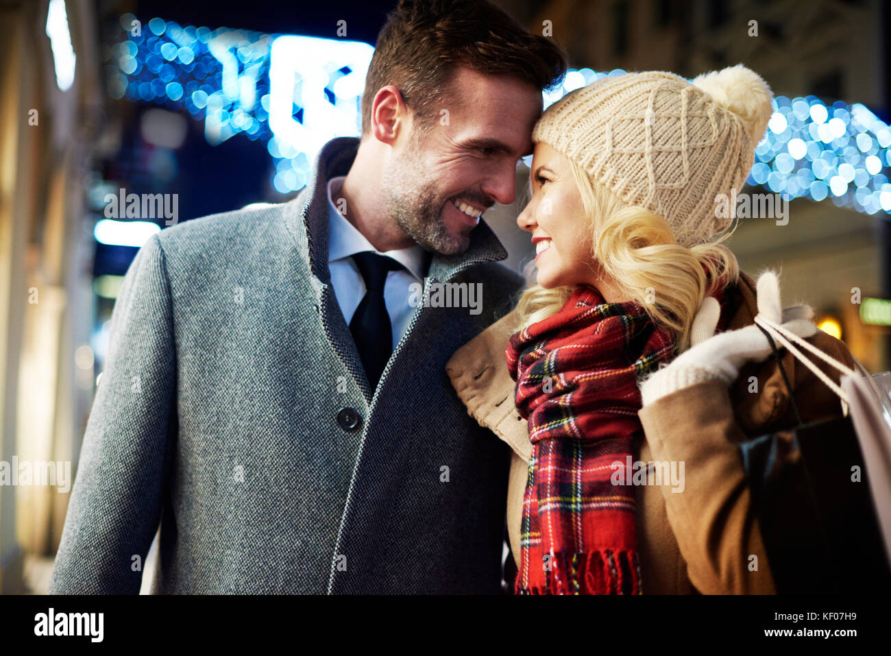 Enamored couple at night time in the town Stock Photo