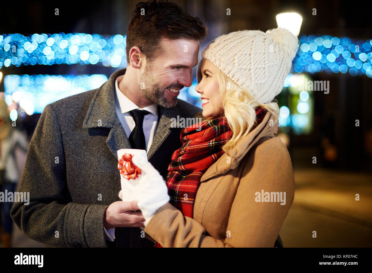 Picture of man bestowed woman by small present Stock Photo