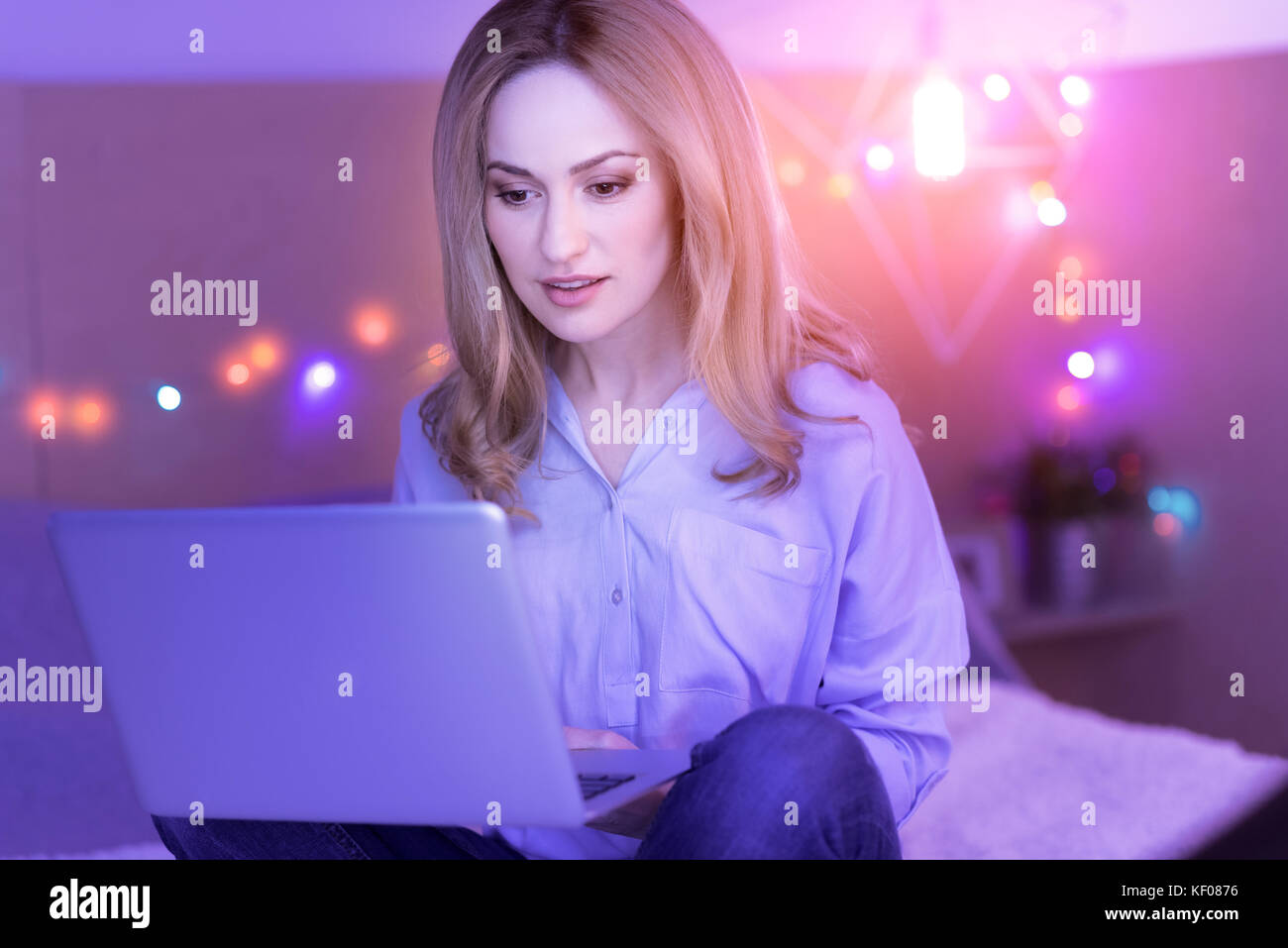 Happy woman working from home - Stock Image