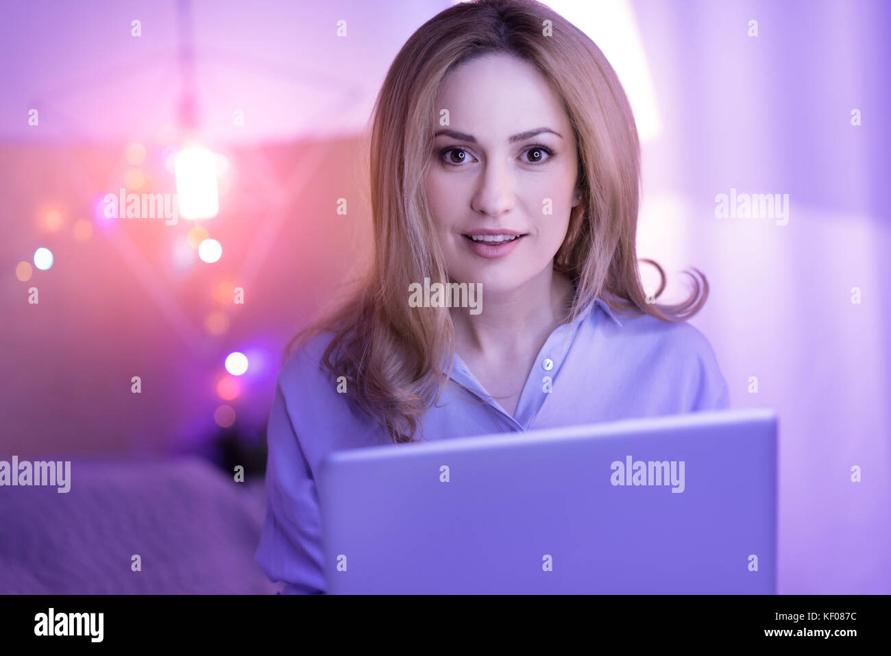 Happy businesswoman working from home - Stock Image