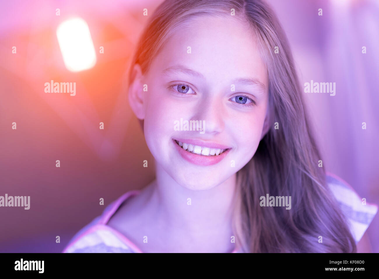 Contend blue-eyed blond girl smiling Stock Photo