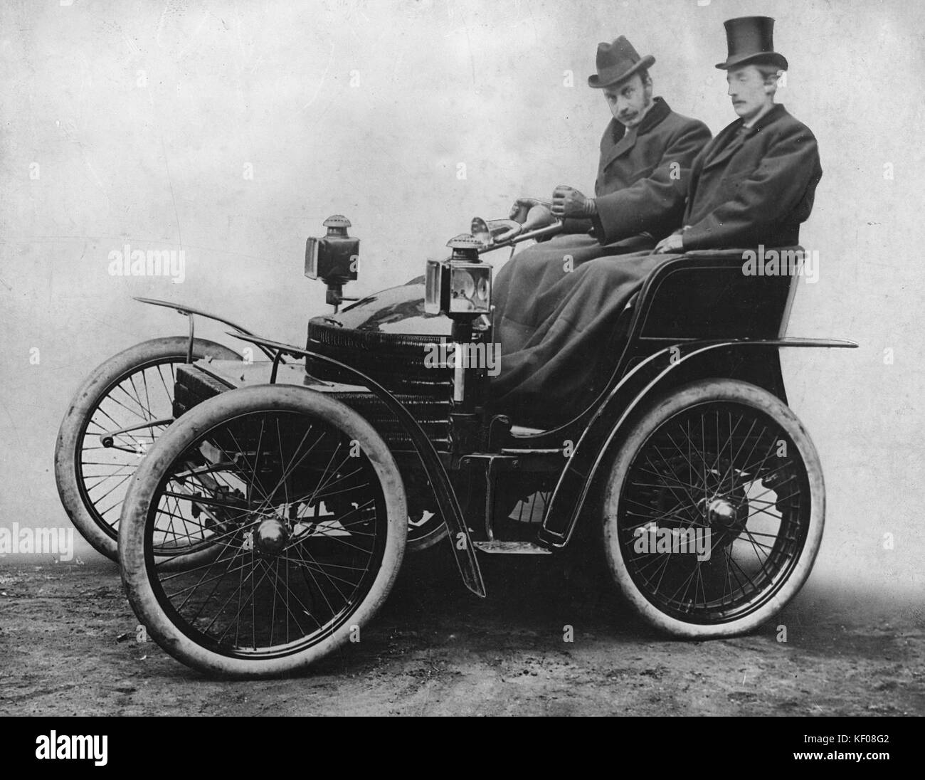 Lord Austin of Longbridge at Tiller of first 4 wheeled Wolseley, designed ad driven by himself on 1000 mile trial - Stock Image