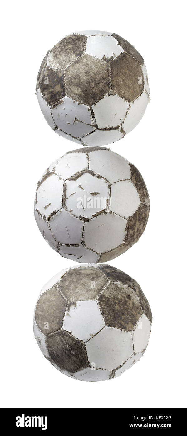 Worn Out Footballs on White Background - Stock Image