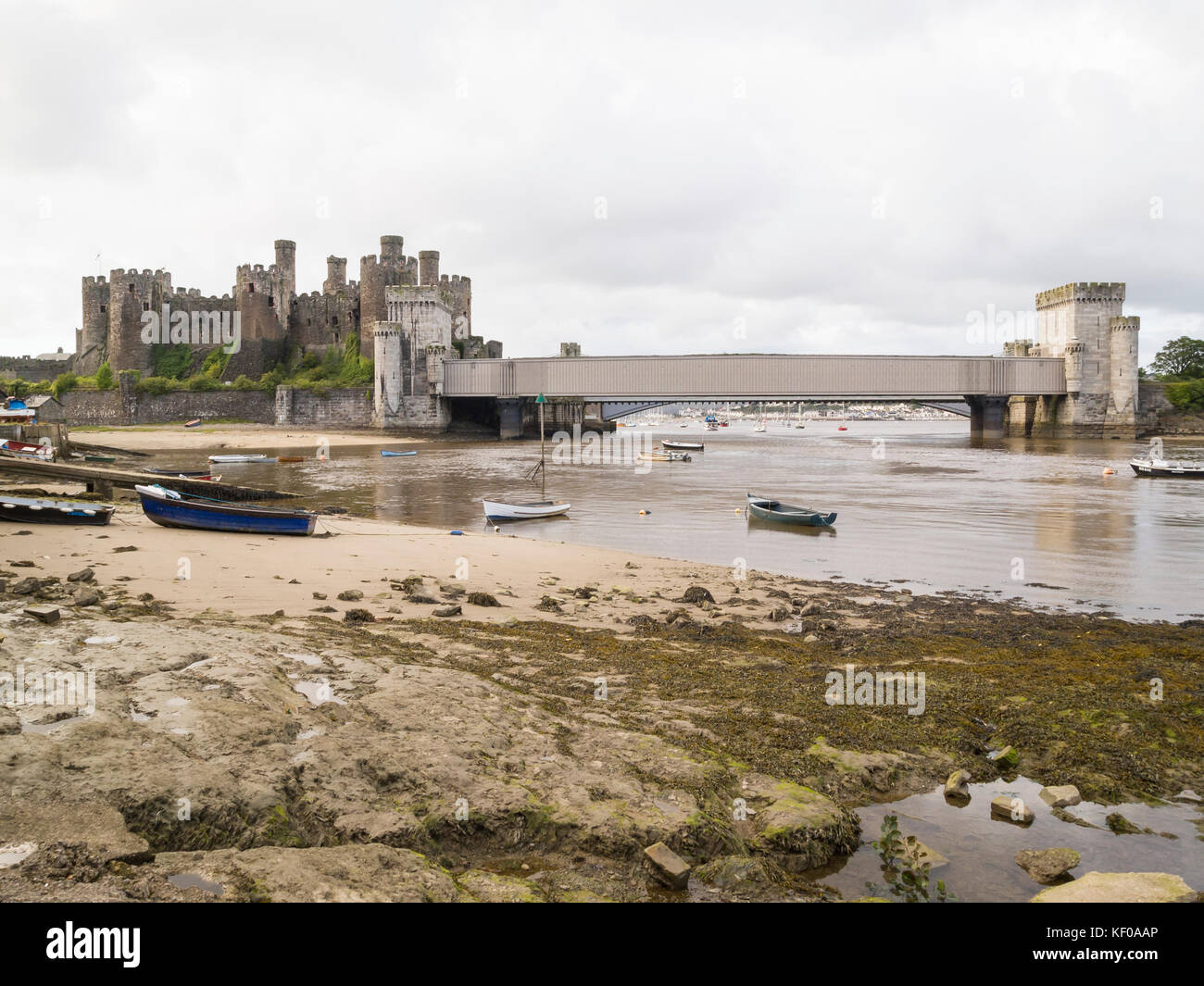 Conwy railway bridge and castle view from river slipway Stock Photo