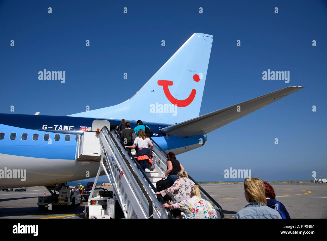 Passengers boarding a Boeing 737-800 airplane at Heraklion Airport, Crete, Greece. - Stock Image