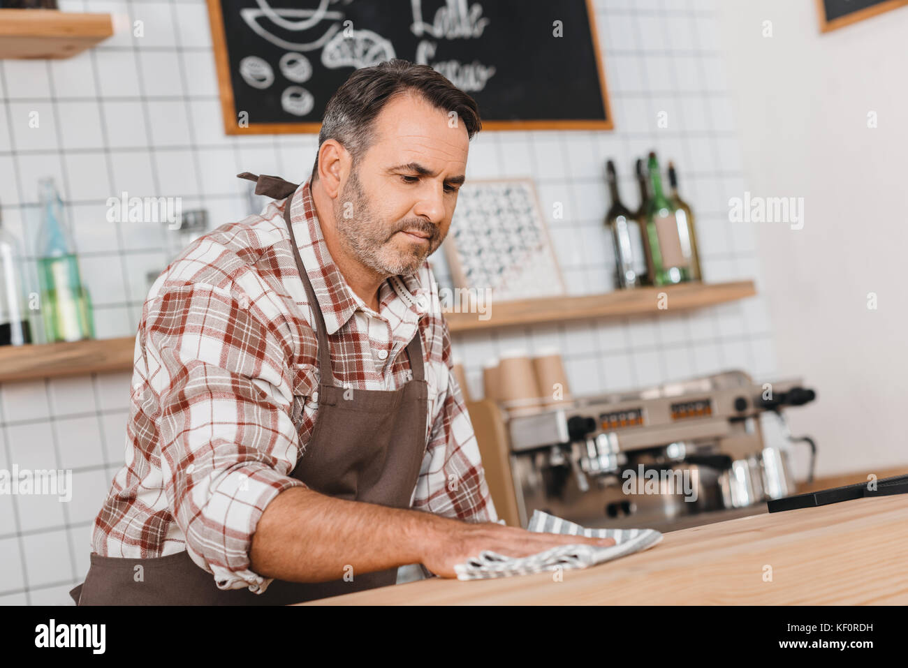 bartender wiping bar counter - Stock Image
