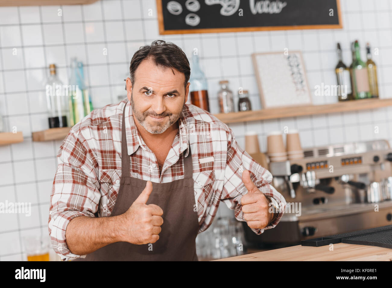 bartender showing thumbs up - Stock Image
