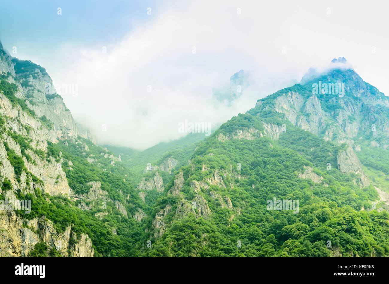 Beautiful view of green Ossetian mountain peak - Stock Image