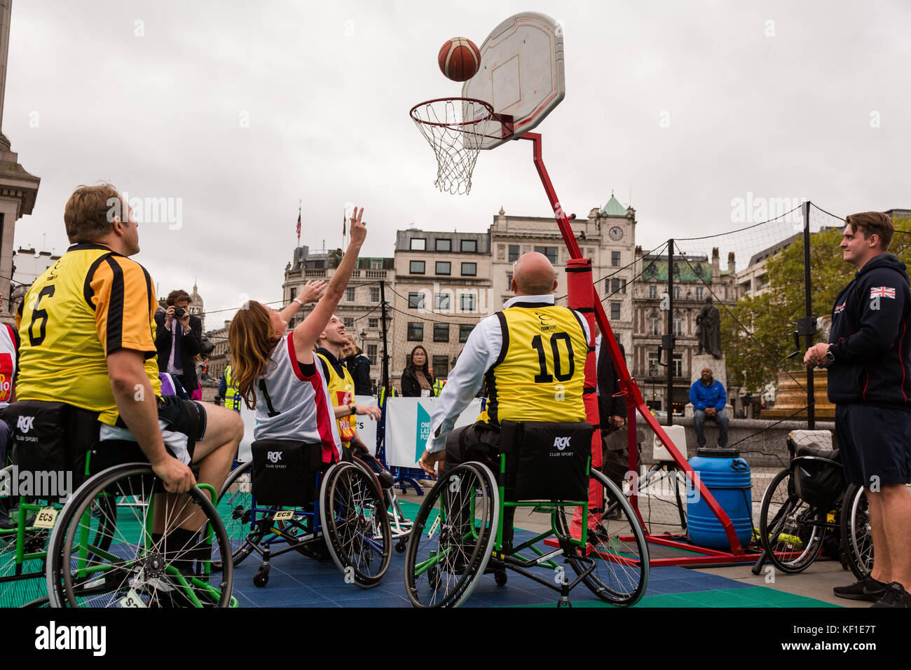 London, UK. 24th October, 2017. Conservative MP Gillian Keegan shoots and scores in a wheelchair basketball match - Stock Image