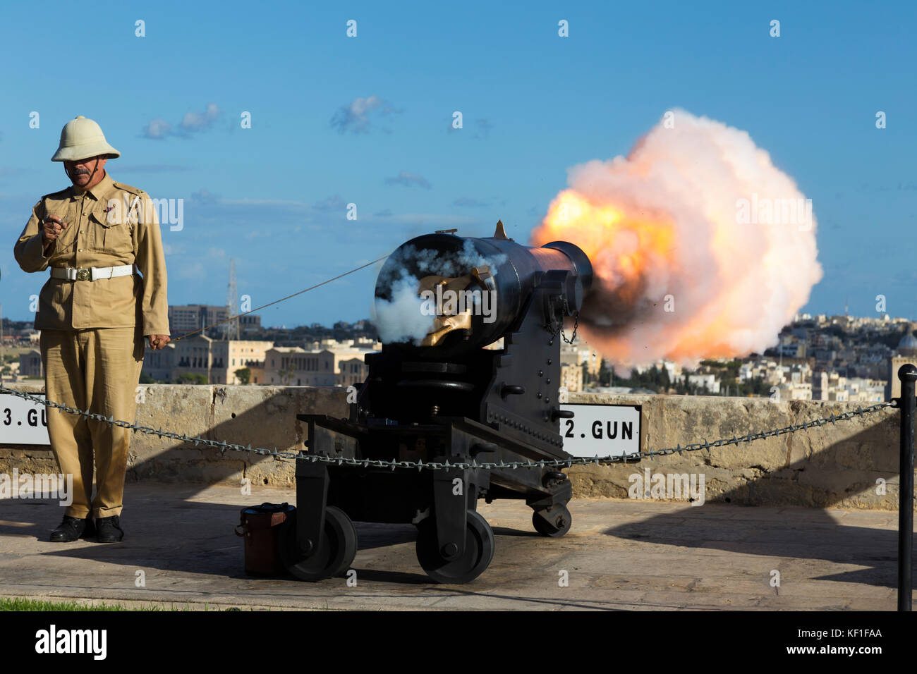 The Number 2 Gun of the Saluting Battery fires the 4pm time signal and is captured at the moment of detonation. - Stock Image