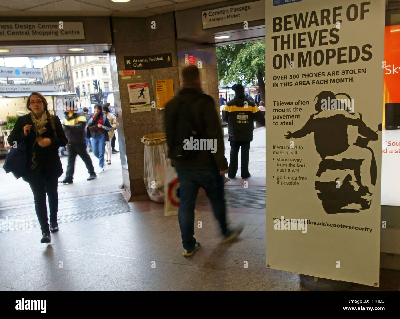 Police poster in Tube station warning about moped riding thieves, London - Stock Image