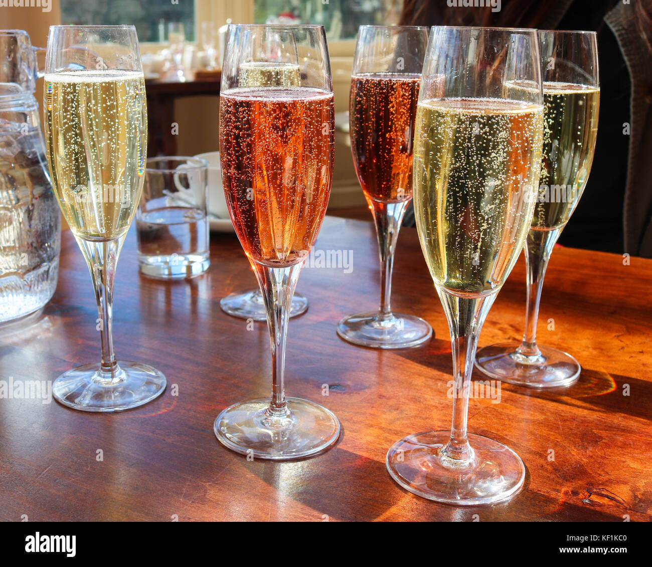 Array of Colorful Champagnes in Flutes - Stock Image