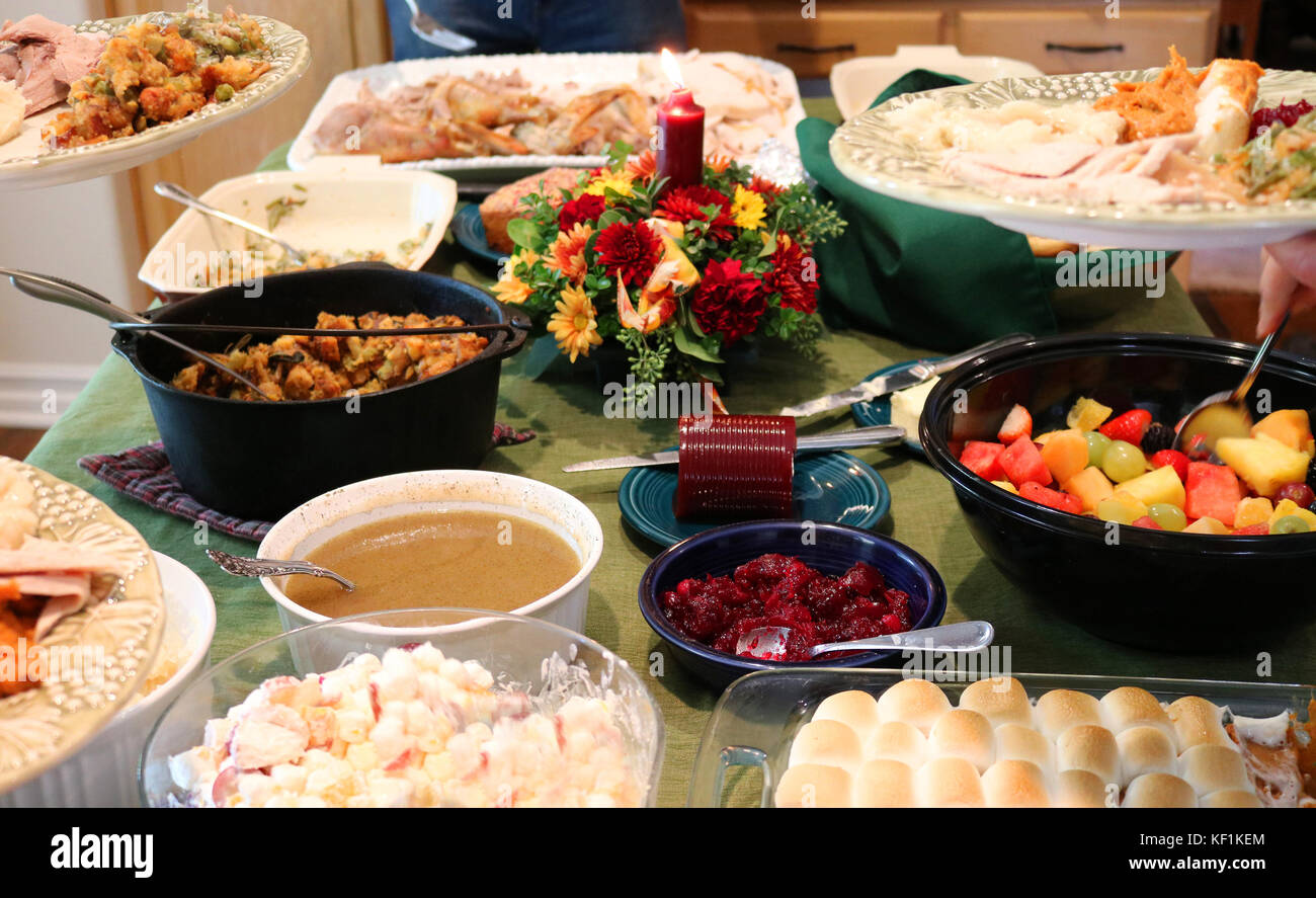 Casual Thanksgiving table spread with traditional food - Stock Image