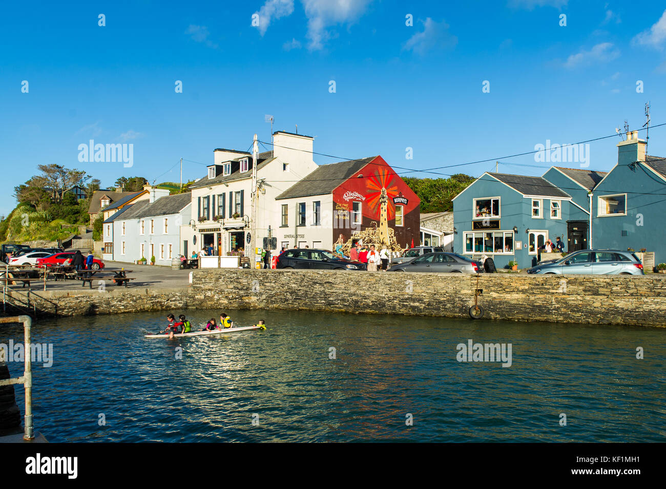 Crookhaven, West Cork, Ireland on a summers day with children playing in water and lots of tourists with copy space. - Stock Image